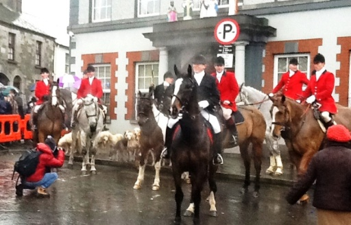 Master of the Hunt and Hunt Servants in red coats with hounds anxiously waiting for the St. Stephens Day Fox Hunt in Kells Ireland.