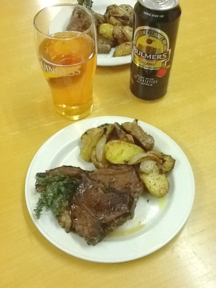 Balsamic,herb & garlic marinated Irish Lamb chops with roast new potatoes & onions....and a nice cider on the side!