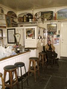 Paddy a local sheep farmer, enjoying pints and conversation in Curran's Haberdashery & Bar in Dingle Ireland.