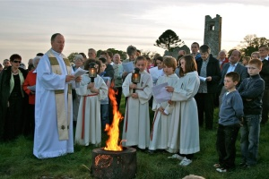 Father Joe and Slane Parish with the Holy Saturday fire on The Hill of Slane.