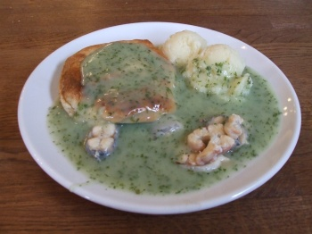 "Goddard's minced pie and mash with stewed eels smothered in green ""liquor"" a.k.a. Parsley sauce"