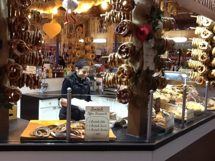 Pretzels, anyway and every way to savor. A stall in a wonderful old market building in Colmar, Alsace, France.