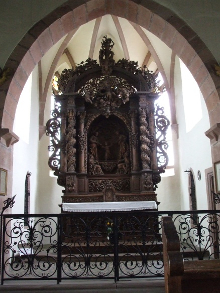 An awe inspiring carved altar in a hillside church in the village of Dambach la Ville