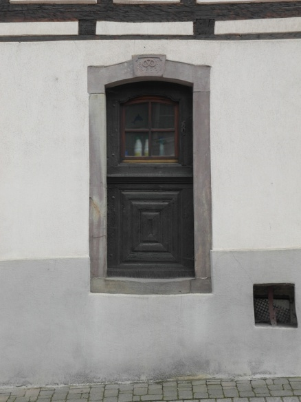 Many homes along the main streets still show the old markings of who once occupied the building. Tis one bears the mark of a pretzel above the tiny door, indicating it was the boulangerie.