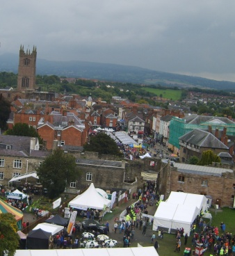An early morning shot from atop the castle tower looking over just a tiny portion of the Festival and out across Ludlow Town