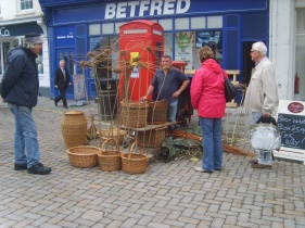 The Wicker Man chatting up on the square market