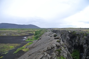 Nature's power is evident as massive cracks in the earths crust trail on for miles in the shadow of Hverfjall crater, housing geothermal hot springs throughout.