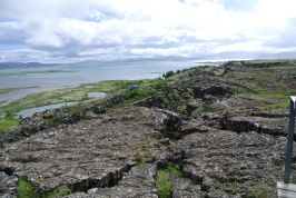 Pingvellir lake surrounded by lava fields and evidence of massive earthquakes in the past.
