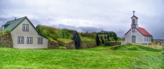 The original longhouse structure lies inside centuries of additions at Keldur historic site.