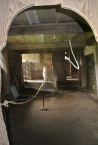 Partial interior of original main hearth room, notice the trap door in the floor leading the escape tunnel. Apologies for photo quality, camera battery was dying.